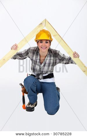 Construction worker with a timber apex