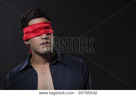 close up of a man blindfolded
