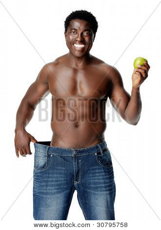 Healthy slim man shows off his thin waistline after some dieting and weightloss. healthy lifestyle black african man