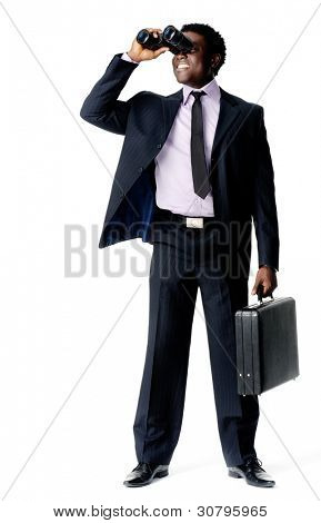 Businessman searches for a new company vision with his binoculars and briefcase