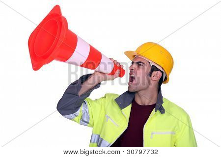 Manual worker shouting through cone