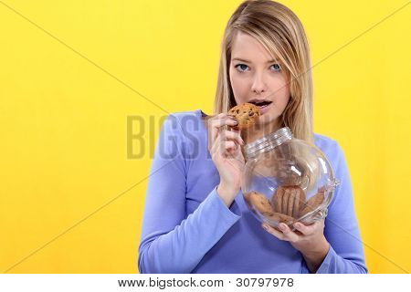 Cute blond eating cookies.