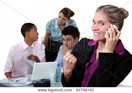 Businesswoman delighted with her phone call