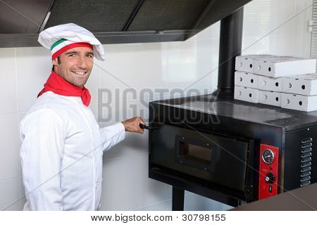 Pizzeria chef next to oven
