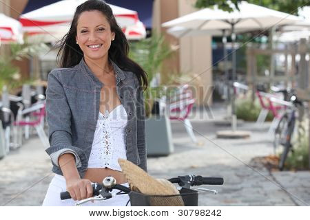 Woman on bike in front of cafe