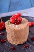 Foie Gras Garnished With Berry Sauce And Sea Salt On The Black Plate poster