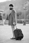 Carry Travel Bag. Man Bearded Hipster Travel With Luggage Bag On Wheels. Adjust Living In New City.  poster