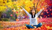Happy Woman Enjoying Life in the Autumn on the Nature poster