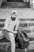 Getting Some Rest And Hiking More. Caucasian Hipster Relaxing On Stairs With Hiking Backpack. Bearde poster