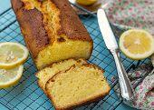 Moist And Fluffy Homemade Lemon Cake Loaf On Blue Background poster