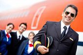 foto of cabin crew  - Captain pilot with his cabin crew at the airport - JPG