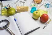 Food Safety Laboratory Procedure, Analysing Fruits From The Market. Notebook And Blue Pen On The Lab poster
