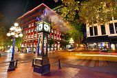 Night View Of Historic Steam Clock In Gastown Vancouver,british Columbia, Canada poster