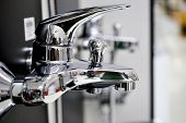Water Faucet, Bathroom Faucet And Kitchen Faucet. Chrome-plated Metal. Shallow Dof.pictured In A Sho poster