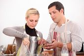 picture of wife-beater  - husband and wife whisking mixture - JPG