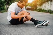 Men With Knee Pain While Jogging poster