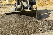 Tractor Collects Scoop With  Gravel. Excavator Extracts Sand And Gravel For  Concrete Mix. poster