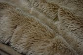 Soft Coffee Synthetic Fabric In The Form Of Natural Long Fur. Brown Synthetic Fur In Spacing Arrange poster
