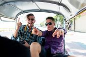 Two Tourist Man Friends Being Excited And Having Fun On Local Tuk Tuk Taxi While Traveling In Bangko poster