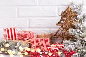 Decorative Fur Tree, Wrapped Christmas Presents, Fur Tree Branches, Balls And  Red Berries  With Bok poster