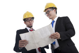 picture of blue-collar-worker  - Architect and construction engineer or surveyor discussion plans and blueprints - JPG
