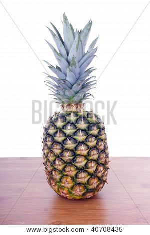 Pineapple On Wooden Table Whith White Background
