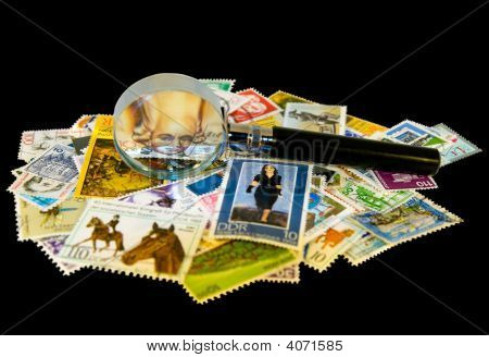 Magnifier And Old Stamps