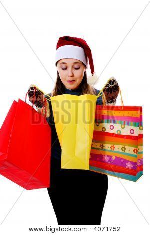 Chica con tres bolsos