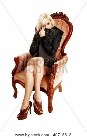Girl Sitting In Armchair.