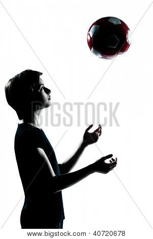 one caucasian young teenager silhouette boy girl tossing soccer football portrait in studio cut out isolated on white background