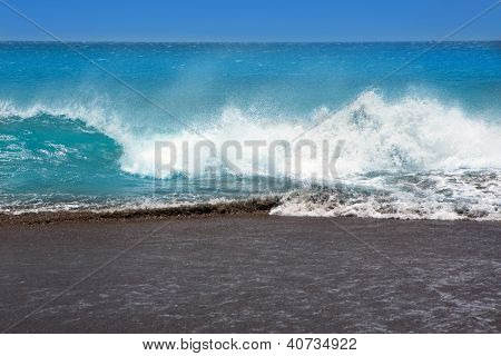 Canary Islands brown sand beach and tropical rough turquoise waves