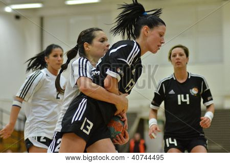 SIOFOK, HUNGARY - JANUARY 5: Babett Szalai (black 13) in action at a Hungarian National Championship handball match Siofok KC (black) vs. Budapest SE (white) January 5, 2013 in Siofok, Hungary.