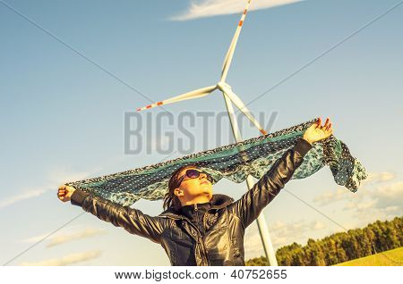 Girl Holding Canvas-cape And Windturbine In Background