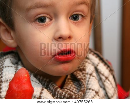 Toddler eating a fruit popsicle