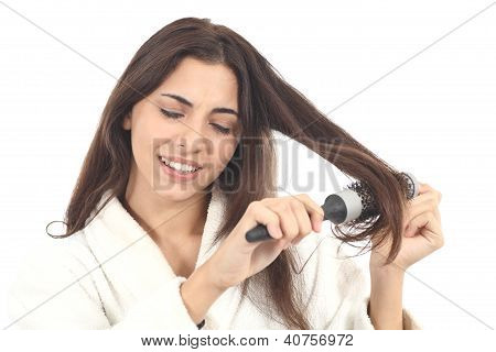 Woman Suffering Combing With The Hairbrush