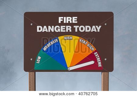 Extreme fire danger today sign with smoke background.