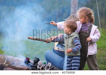 Family Near Campfire