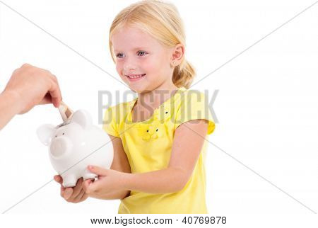 cute little girl with piggybank receiving money