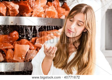 Wellness - Young woman inhaling essential oil in salt cave of a Spa