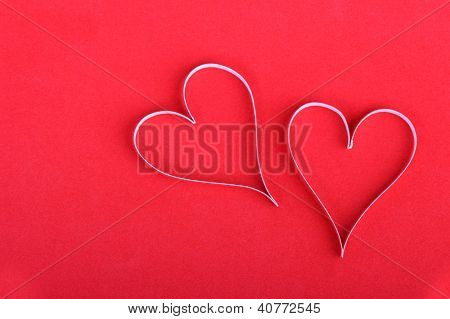 Valentine's paper hearts on the red background