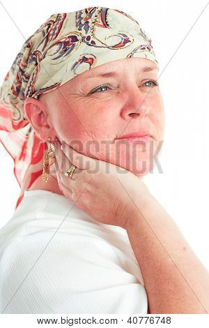 Portrait of a beautiful, courageous cancer patient in a head scarf.  White background.