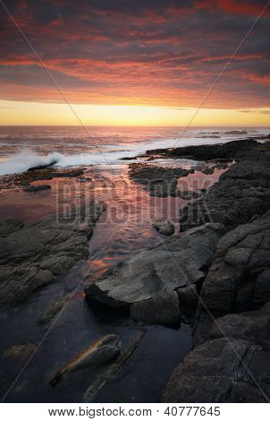 Sunset over rocky coastline (Hermanus - Cape Province - South Africa)