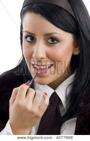 Fashionable Woman Applying Lipstick