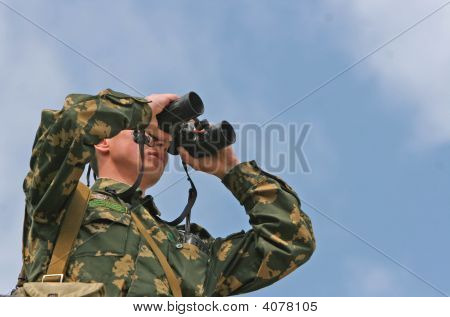 Border Guards In The Stands With Binoculars