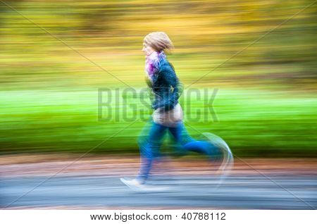 Girl Jogging In The Forest