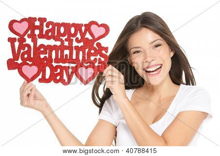 Valentines day. Woman showing holding sign excited with the text VALENTINES DAY.  Lovely happy multiracial Caucasian / Asian Chinese young woman isolated and cut out on white background in studio.