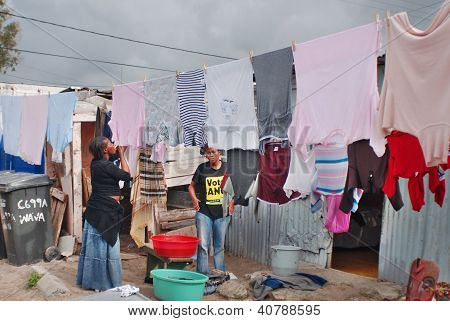 Women hang their clothes in Khayelitsha township