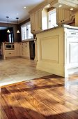 pic of residential home  - Hardwood and tile floor in residential home kitchen and dining room - JPG