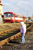image of motor coach  - little girl and engine carriage at railway station of Dobruska - JPG