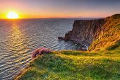 stock photo of atlantic ocean  - Cliffs of Moher at sunset in Co - JPG